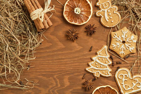joyeux: Christmas gingerbread on wooden background with various decoration