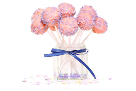 Cake pops in a jar on a white background