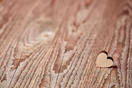 Little heart figure on wooden background Stock Photo