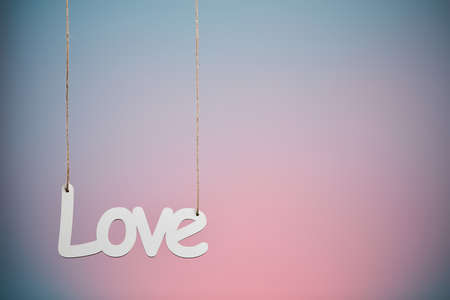White love sign hanged on blue background Stock Photo