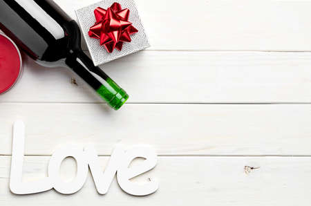 st  valentine: love, gift, box, bow, ribbon, wine, bottle, alcohol, confetti, drink, wood, wooden, glass, heart, sweet, celebration, neon, sign, couple, warm, candle, tea light, date, diner, red , white, table, st valentine, valentines day, be my valentine, affection,
