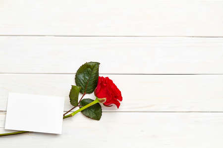 White wooden background with love letter and rose Stock Photo