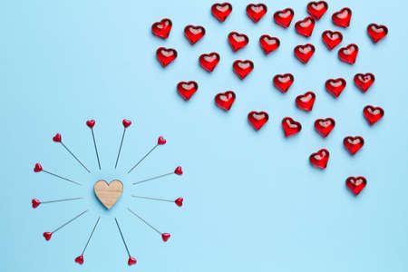 trouble free: Blue empty background with little heart surrounded by pins and cloud made of red crystals
