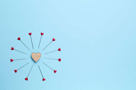 trouble free: Blue empty background with little heart surrounded by pins