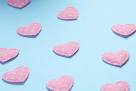 pink hearts: Pink hearts on blue background Stock Photo