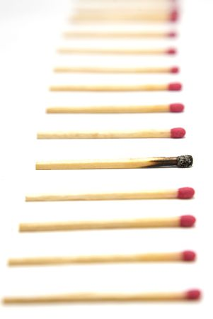 Row of matches with one standout photo