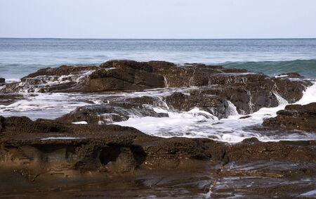 gush: Waves over rocks Stock Photo