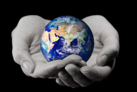 Holding the World (2 hands holding the globe,with a soft DOF on the hands) Stock Photo - 4445450
