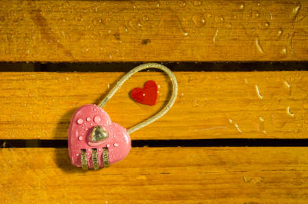 master key: Pink master key on wood pattern background Stock Photo