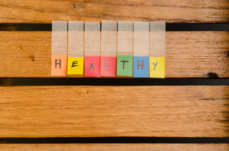 Healthy alphabet on wood pattern background Stock Photo - 25081521