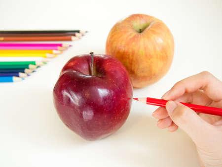 colored pencil: looks like drawing apples with the colored pencil Stock Photo