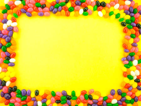 Frame and background made of colorful jelly beans.