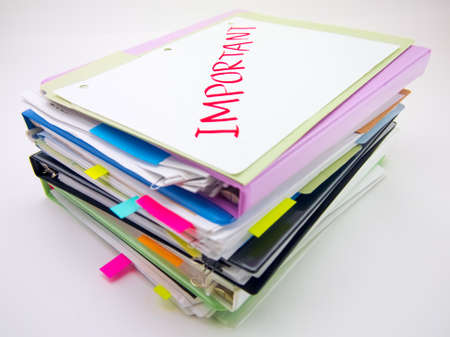 stack of documents: There is the huge pile of business documents on the desk.