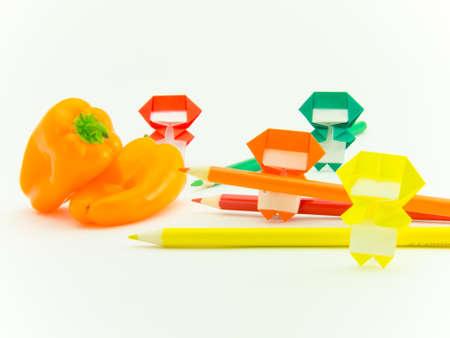 ninja: Colorful origami Ninja playing with the vegetables and fruits. Stock Photo