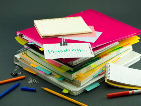 pending: The Pile of Business Documents; Pending