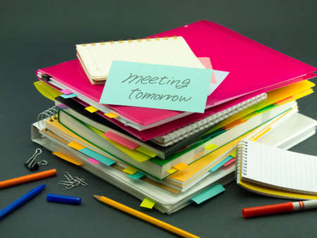 tomorrow: The Pile of Business Documents; Meeting Tomorrow Stock Photo