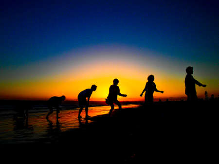 human evolution: The Sun Set And Silhouette of Human Evolution at the Coronado Beach in San Diego  in June
