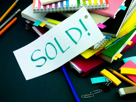 hard sell: Somebody Left the Message on Your Working Desk; Sold Stock Photo