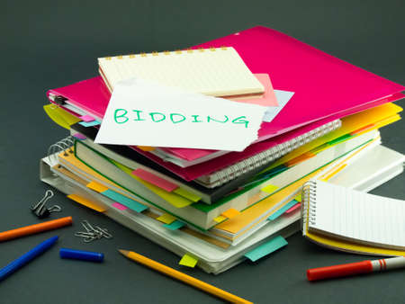 bidding: The Pile of Business Documents; Bidding Stock Photo