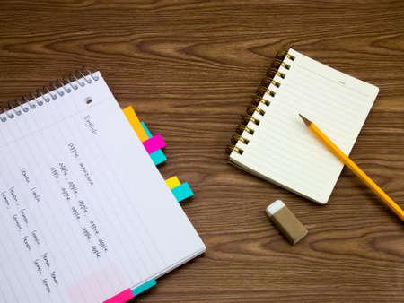 language learning: English; Learning New Language Writing Words on the Notebook