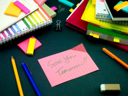 Somebody Left the Message on Your Working Desk; See You Tomorrow Foto de archivo