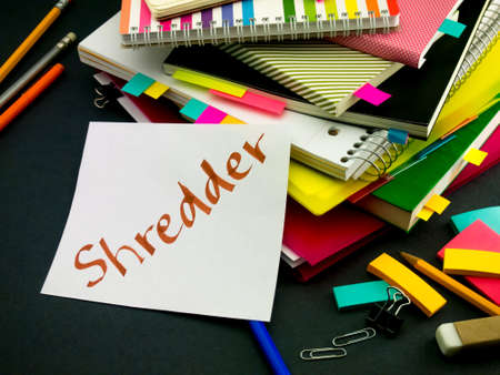 shredder: Somebody Left the Message on Your Working Desk; Shredder Stock Photo