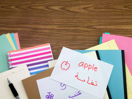 learning arabic: Arabic; Learning New Language Writing Words on the Notebook