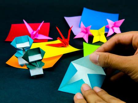Juguetes Origami japonés Instrucciones plegables; Cómo jugar Foto de archivo