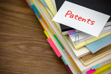 patents: Patents; The Pile of Business Documents on the Desk Stock Photo