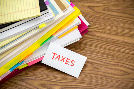 Taxes; The Pile of Business Documents on the Desk Stock Photo