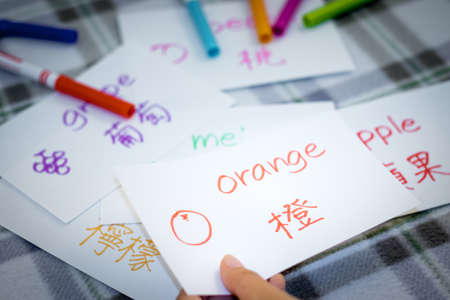 bilingual: Mandarin; Learning New Language with Fruits Name Flash Cards Stock Photo