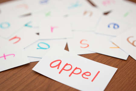 Dutch; Learning the New Word with the Alphabet Cards (Translation; Apple) Stock Photo