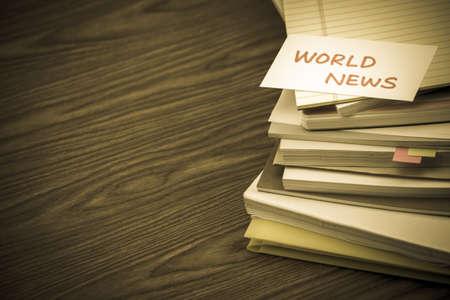 World News; The Pile of Business Documents on the Desk Reklamní fotografie