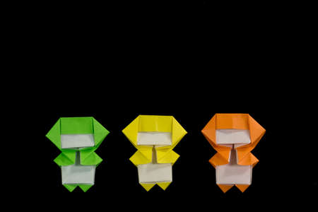 The Handmade Origami Ninja Kids on the Black Background