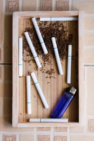 carcinoma: cigarette wood background