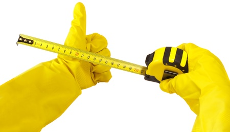 gloved hand holding measuring tape isolated on white background photo
