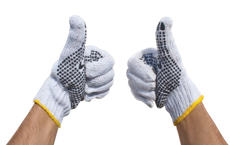 Hands in fabric protective gloves  showing ok  isolated on a white background