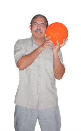 Senior man holding orange bowling ball isolated on white background Stock Photo - 10475667