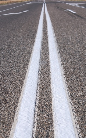 Close up of street lines and arrow direction on the road photo
