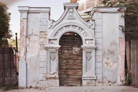 Old dilapidated abandoned gates in Kerch, Crimea, Ukraine photo