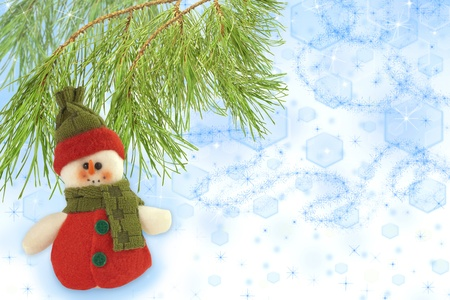 cute snowman under a pine tree on beautiful Christmas background photo
