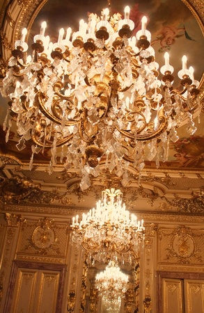 Chandeliers hanging under a ceiling. Interiors of the Polovtsov mansion - Architects house, St.Petersburg, Russia