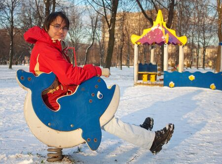 Young man having fun on the winter playground photo
