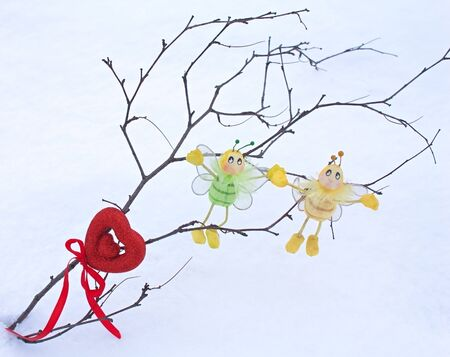 red heart - Valentine with ribbon, bees and branch in the snow photo