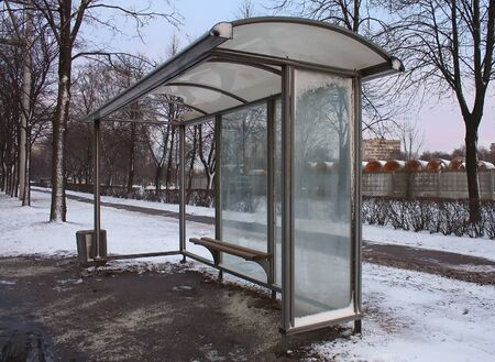 Empty Bus Stop in winter city photo