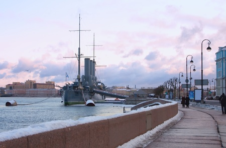Legendary cruiser Aurora ( Warship museum) and Neva embankment in winter day. St. Petersburg, Russia