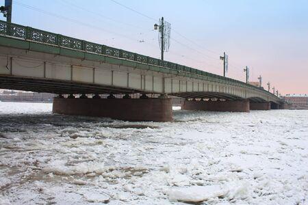 Liteyny Bridge above frozen Neva river. Winter in St. Petersburg, Russia photo