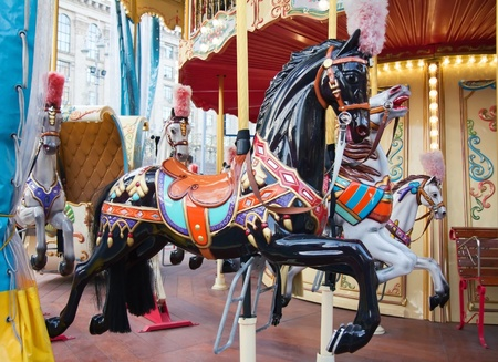fairground: Dark horse ride on a fairground carousel