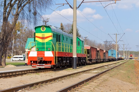 Freight multicolored diesel train on the station photo