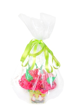 Paper artificial flowers as gift with candy, isolated on white background photo
